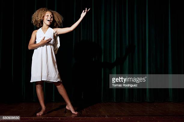 girl singing on stage - actress stock pictures, royalty-free photos & images