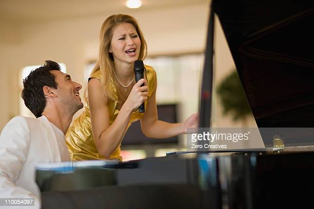 girl singing - pianist front stock pictures, royalty-free photos & images