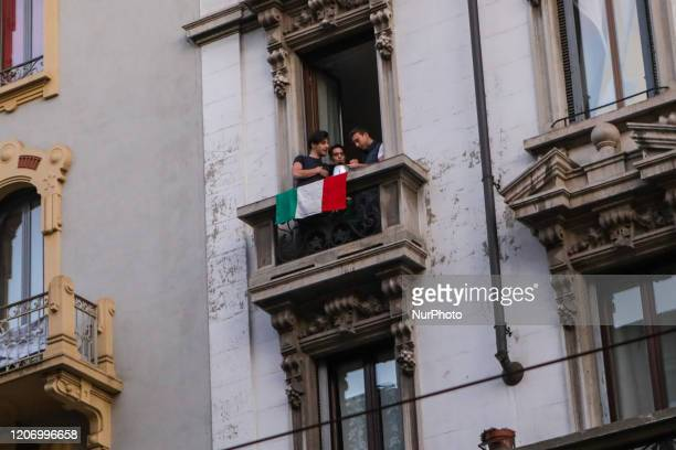 Girl sings from the window during the flash mob, March 13, 2020. Some people have organized a flash mob asking to stand on the balcony and sing or...