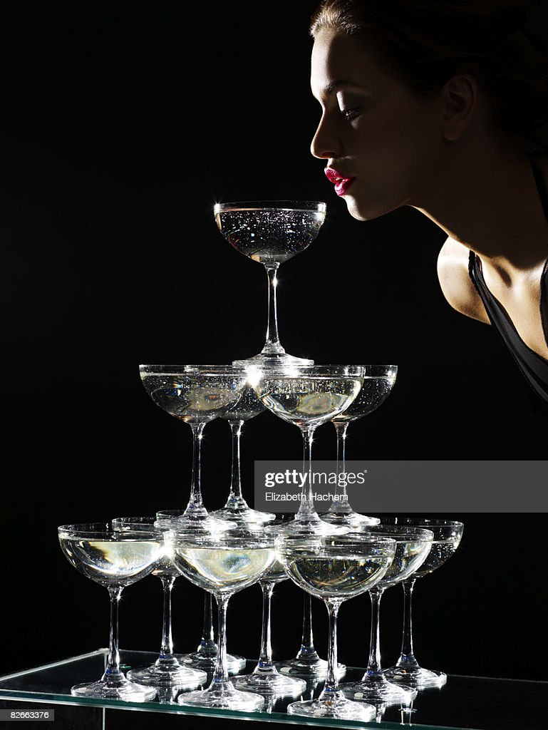 Girl sipping from champagne fountain : Stock Photo