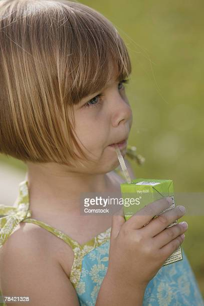 Girl sipping from juice box