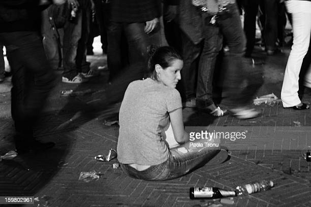Girl sits in the street