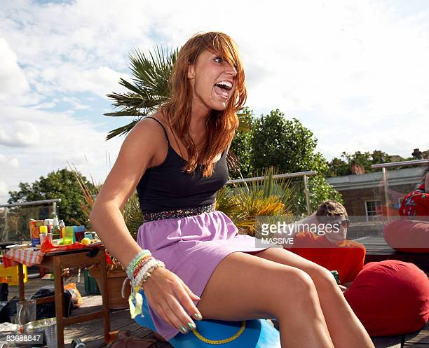 Girl sits on edge of seesaw
