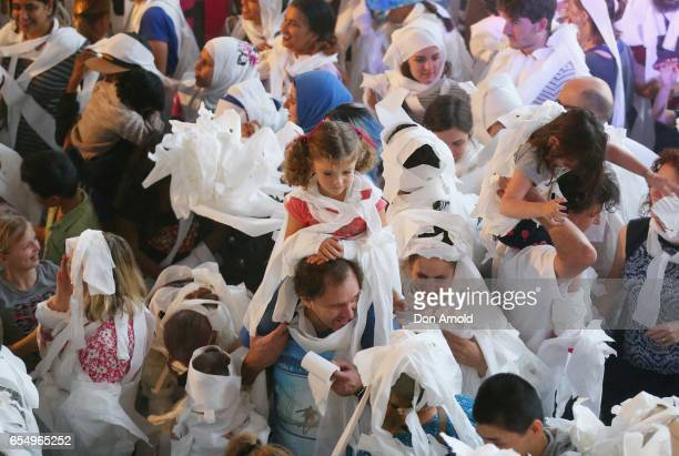 A girl sits on her fathers shoulders at Powerhouse Museum on March 19 2017 in Sydney Australia A total of 846 people wrapped themselves in toilet...