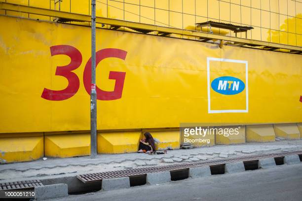 A girl sits outside the main office of MTN Group Ltd in Kabul Afghanistan on Sunday July 15 2018 US President Donald last year said 16000 US troops...