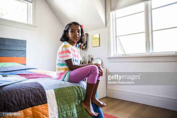 girl sitting alone in her bedroom - african american ethnicity stock pictures, royalty-free photos & images