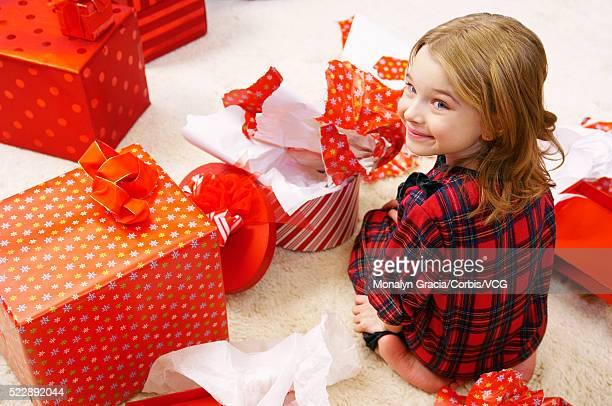 Girl sitting amongst gifts