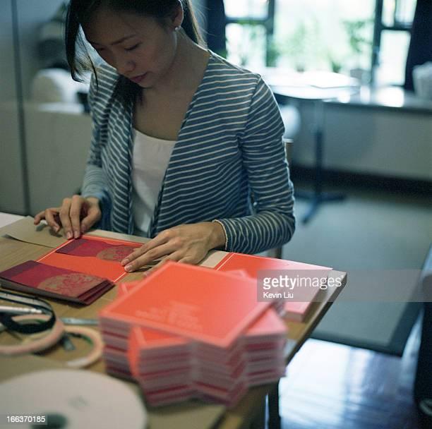 Girl sitting and preparing orange invitation card