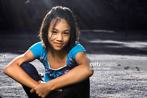 Girl sitting and smiling