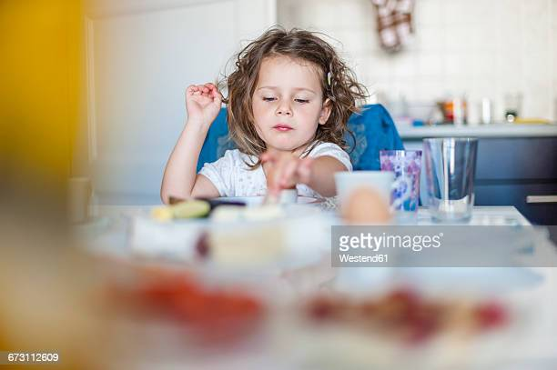 Girl sitting at breakfast table