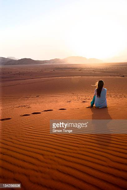 girl sitting at red desert - jordan middle east stock pictures, royalty-free photos & images