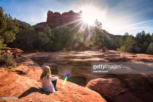 girl sitting at seven sacred pools, sedona - sedona stock photos and pictures