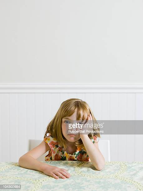 girl sitting at the kitchen table