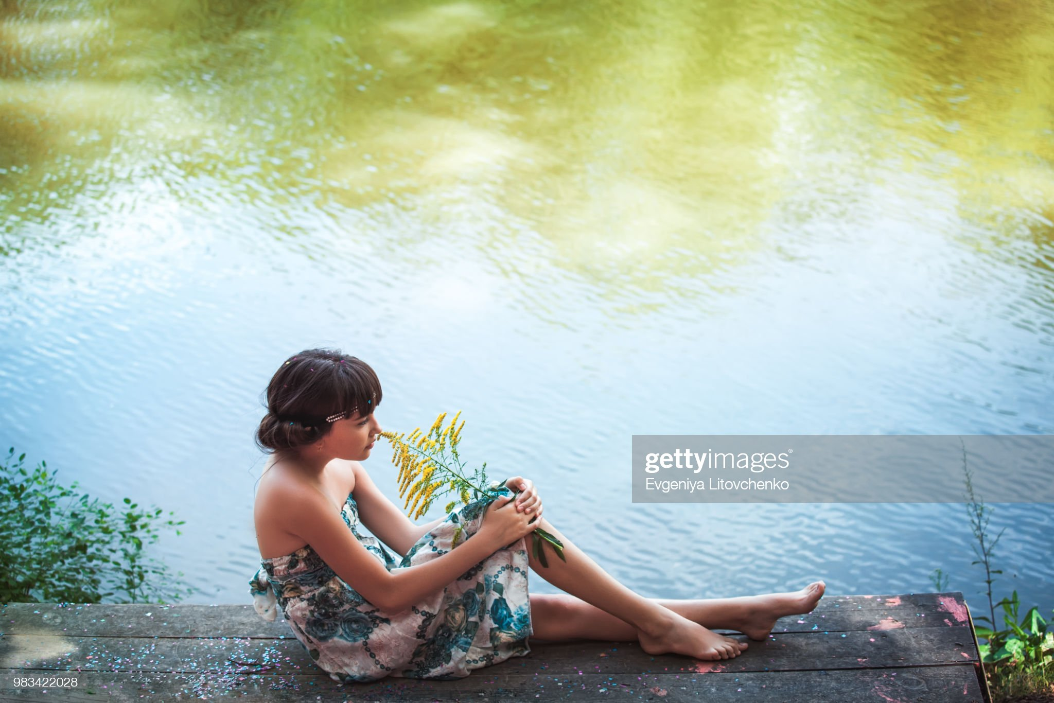 https://media.gettyimages.com/photos/girl-sitting-by-a-lake-picture-id983422028?s=2048x2048