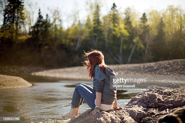 girl sitting by water - duluth minnesota stock pictures, royalty-free photos & images