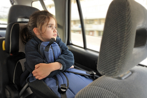 Girl Sitting in a Car Seat on the Way to School - gettyimageskorea