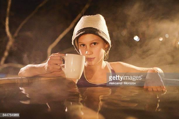 Girl sitting in a Japanese bath Ofuro