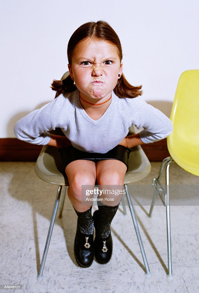 Fantastic Girl Sitting In Chair Making Angry Face Stock Photo Getty Interior Design Ideas Lukepblogthenellocom