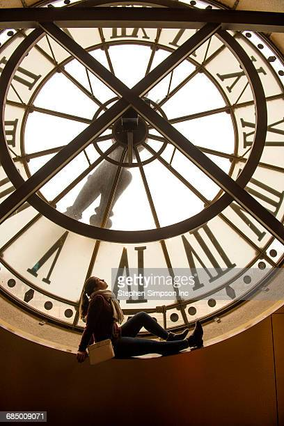 girl sitting in clock window - clock tower stock pictures, royalty-free photos & images