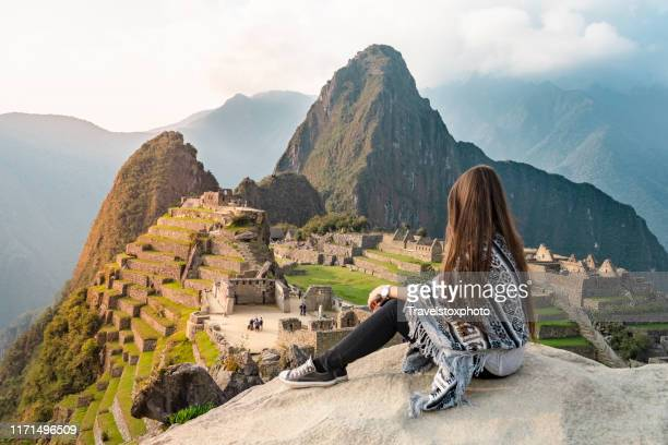 girl sitting in front of machu picchu peru, south america - peru stock pictures, royalty-free photos & images