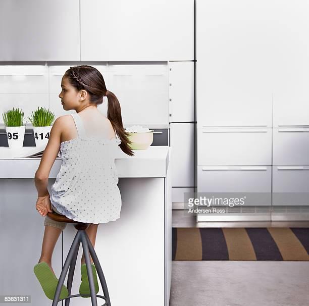 Girl sitting in kitchen