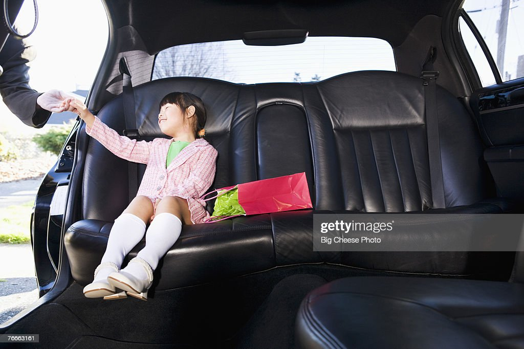 Girl sitting in limousine : Stock Photo