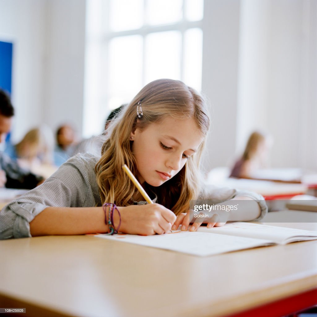 Girl Sitting In School Class Stock Photo  Getty Images-6424