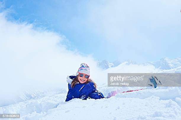 Girl sitting in snow, Chamonix, France