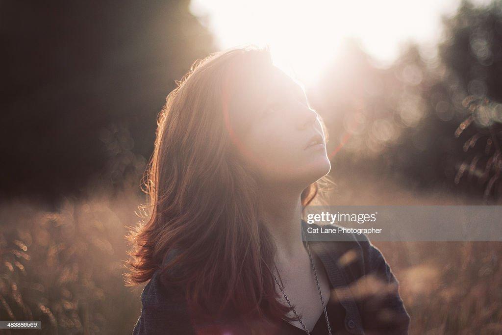 Girl Sitting in Sun : Stock Photo