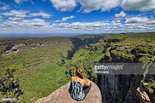 Girl sitting in the edge of cachoeira da Fumaça - Chapada Diamantina