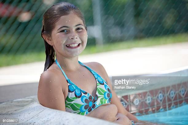 Girl sitting in the swimming pool