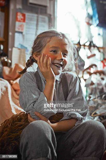 Girl sitting in theatre costume backstage