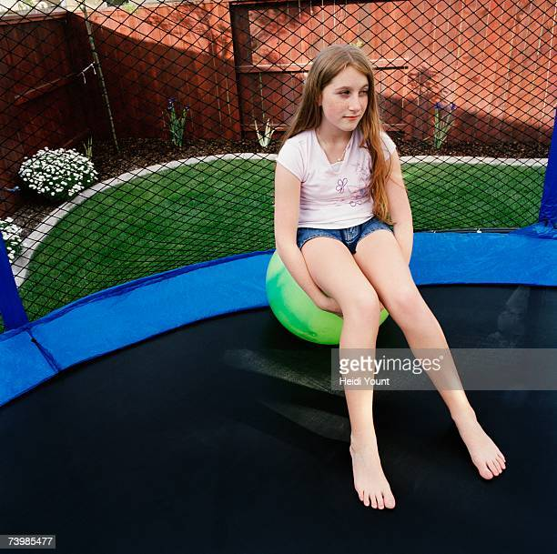 Girl sitting on a ball