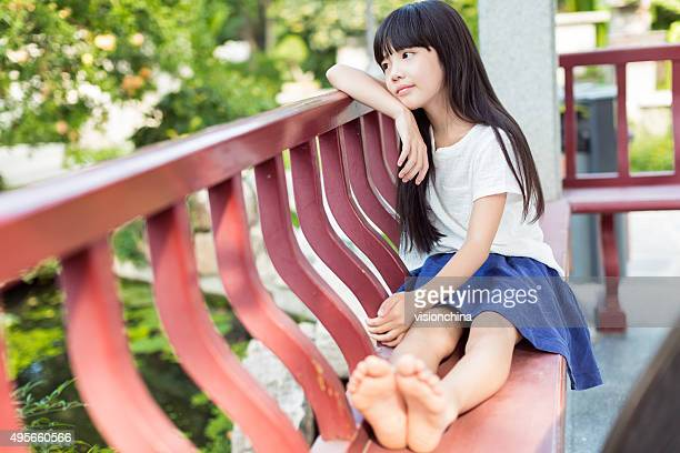 barefoot asian girl