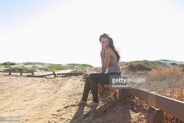 Girl sitting on a fence