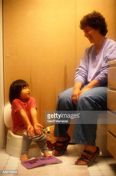 Girl Sitting on a Potty Chair