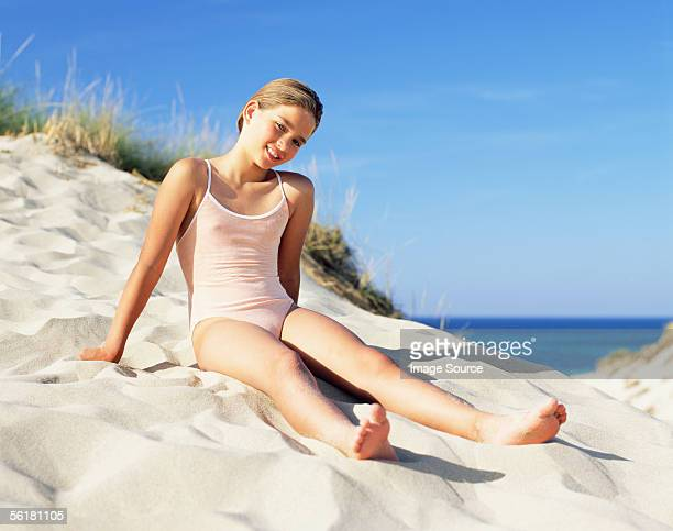 Girl sitting on a sand dune