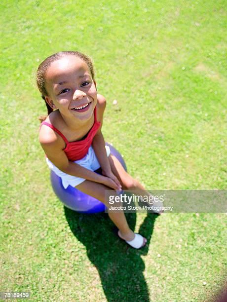 Girl sitting on ball