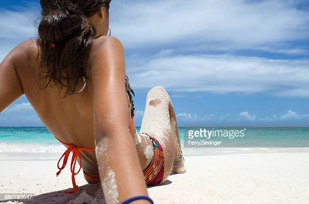 girl sitting on beach, antigua, caribbean - girls sunbathing stock pictures, royalty-free photos & images