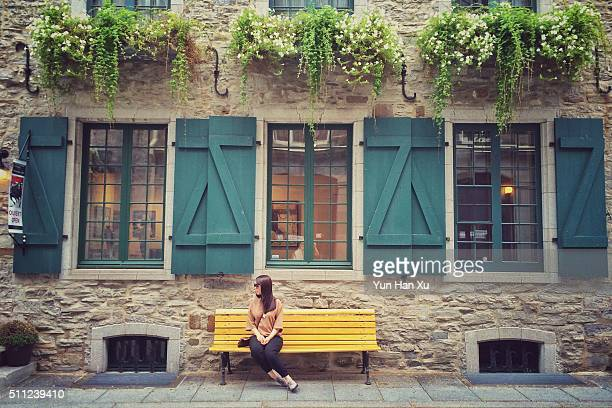 Girl Sitting on Beanch in Old Quebec