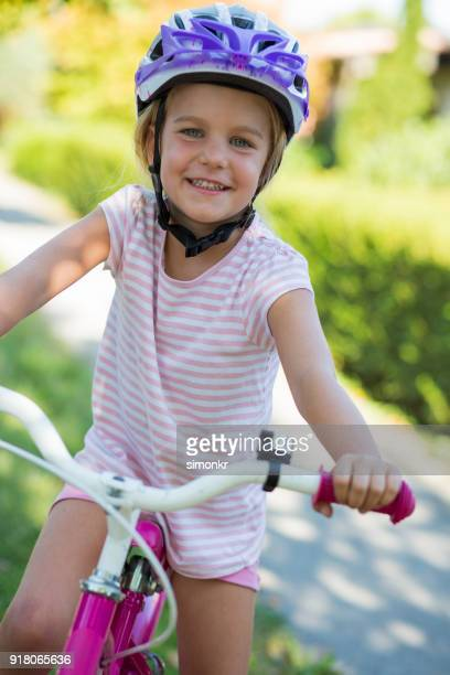 girl sitting on bicycle - cycling helmet stock photos and pictures