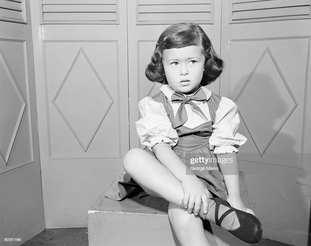 Girl (6-7) sitting on box : Stock Photo