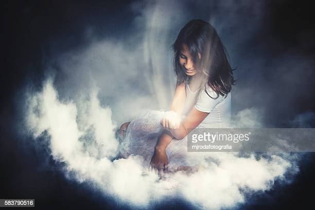 Girl sitting on clouds