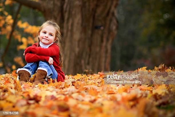 girl sitting on fall leaves - chatham new york state stock pictures, royalty-free photos & images