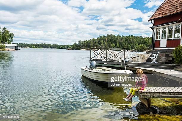 Girl sitting on jetty