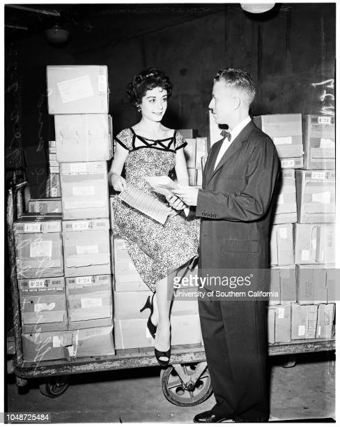 Girl sitting on million dollars worth of stamps 22 July 1958 The new stamps to be on market August 1Miss Sheri Stennette NW Schneringer Caption slip...