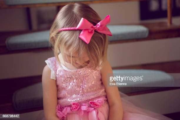 girl (4-5) sitting on naughty step - hair bow stock pictures, royalty-free photos & images