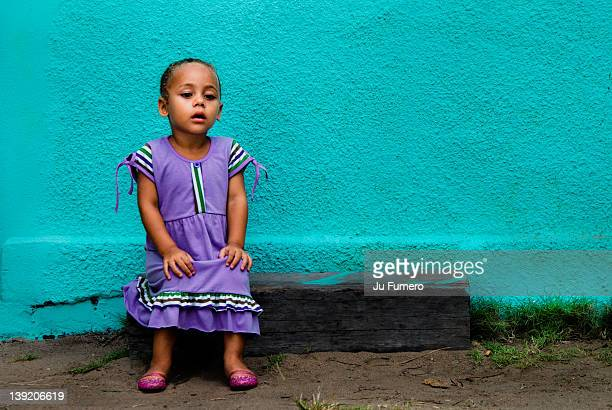 girl sitting on old wood - hand on knee stock pictures, royalty-free photos & images