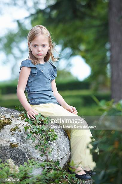 girl sitting on rock outdoors - saint ferme stock pictures, royalty-free photos & images