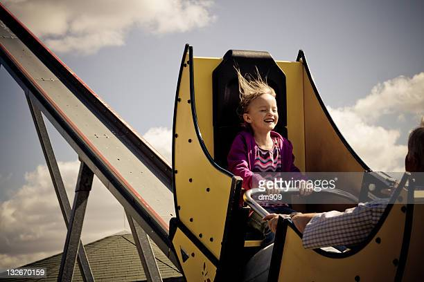 girl sitting on roller-coaster - amusement park ride stock pictures, royalty-free photos & images